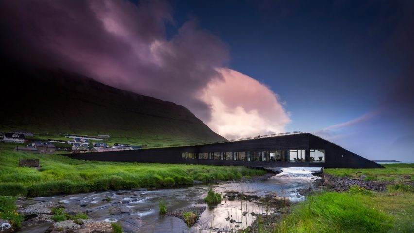 Henning Larsen builds town hall that bridges a river on the Faroe Islands