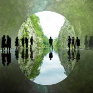MAD transforms Japanese mountain tunnel by adding mirrors, a spa and a lake