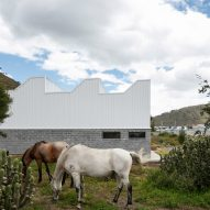 Wavelike roof tops Mikhuna quinoa facility in Ecuador by TEC