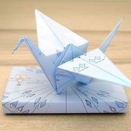 Origami Wrap is a gift wrap printed with folding instructions for origami figures