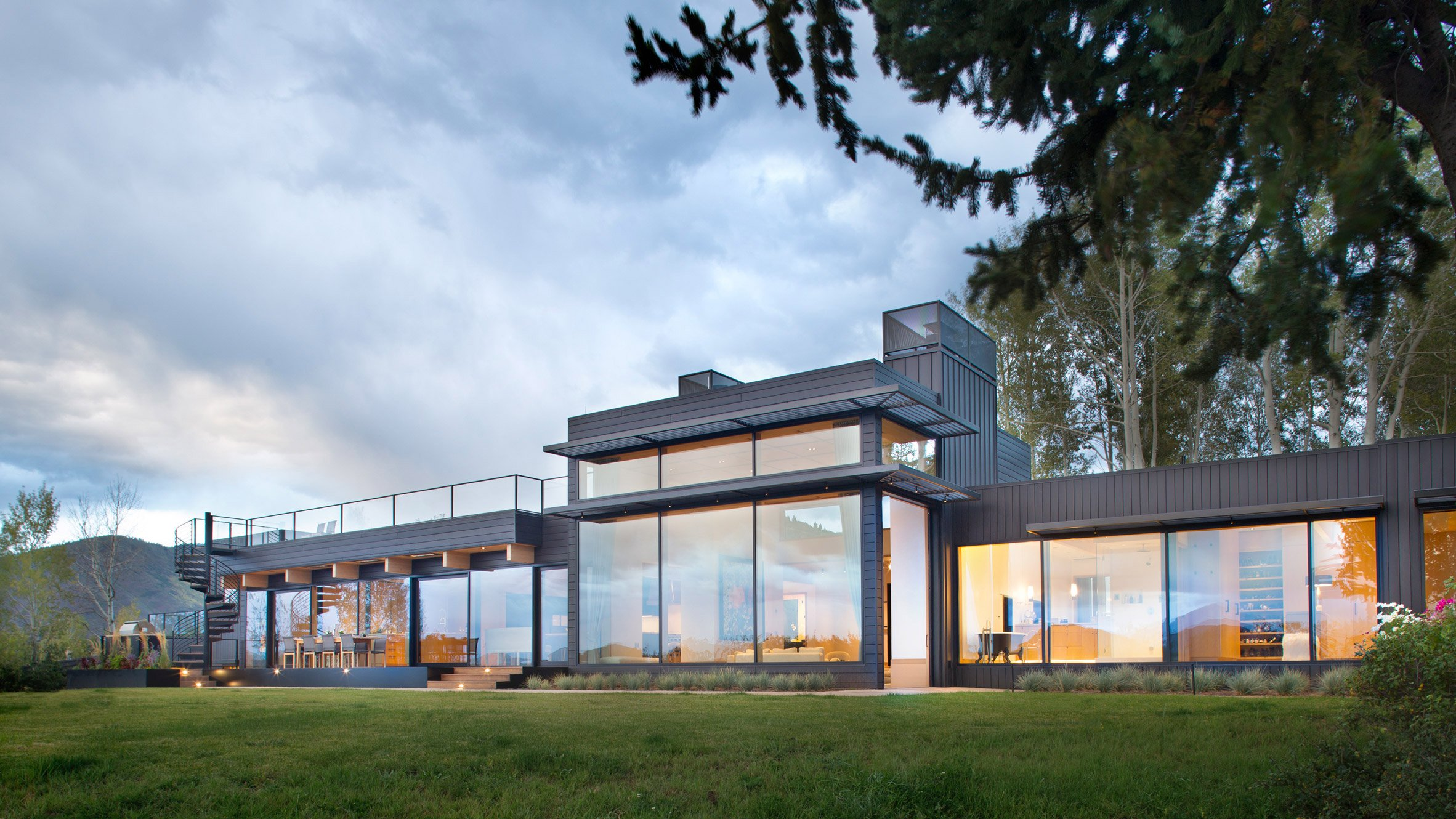 Ridge House by Rowland + Broughton frames views of Rocky Mountains