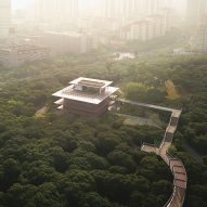 Xiangmi Science Library connected to park by glazed walkway through treetops