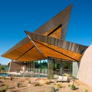 Dancing Light House by Kendle Design Collaborative features dramatic pointy roofs