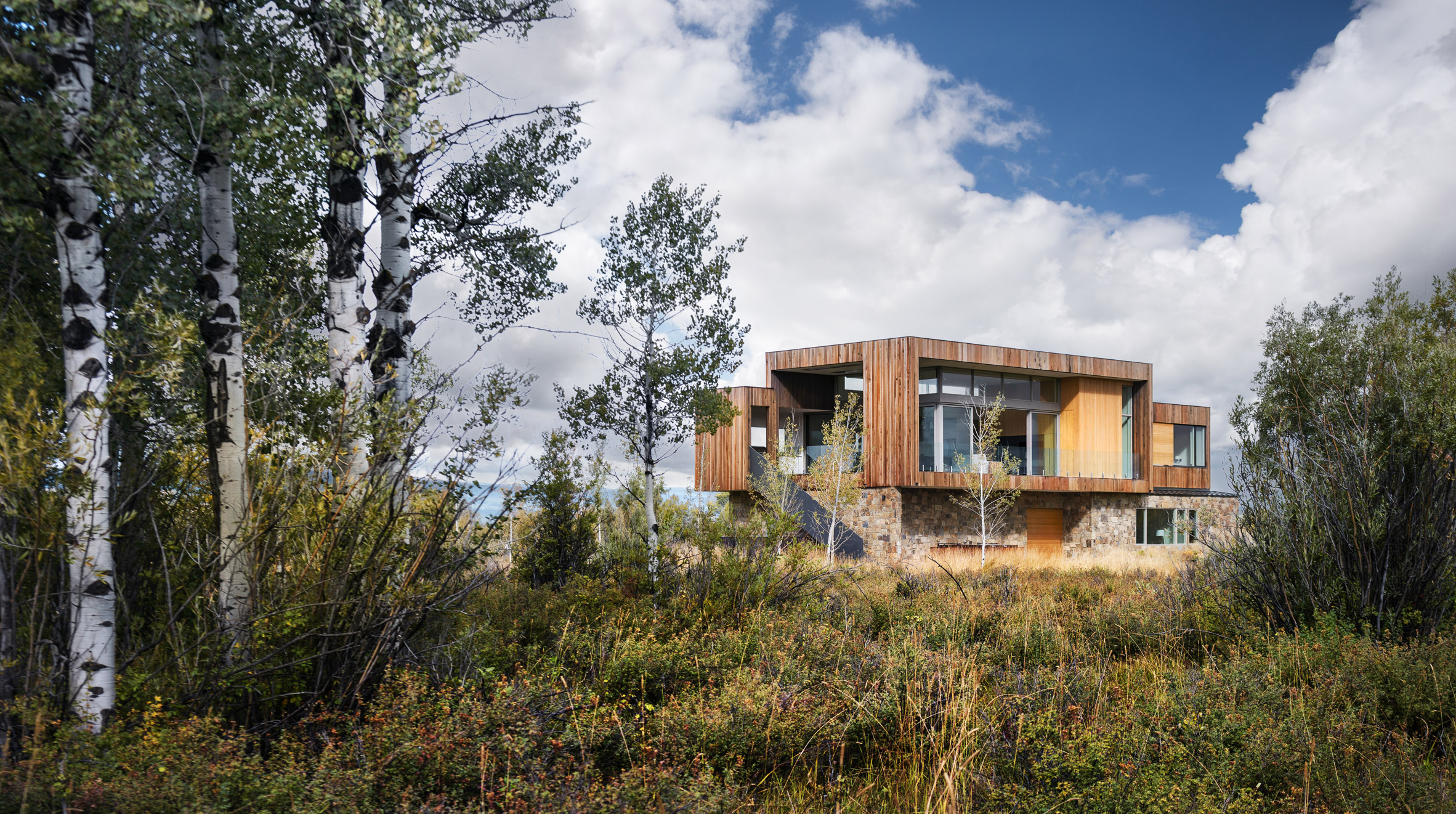 Ro Rockett Design lifts Teton Valley Residence on stone walls