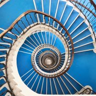 """Infinite"" spiralling staircases in Budapest captured in photography by Balint Alovits"
