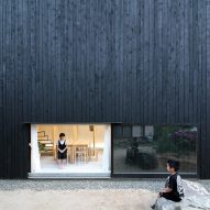 Katsutoshi Sasaki's minimalist home contrasts a dark exterior with a light interior