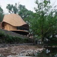 Treewow Retreat is a Chinese village house featuring a round freeform roof