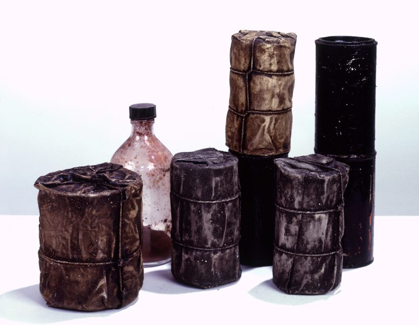 Wrapped Cans and a Bottle by Christo