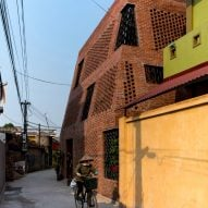 H&P Architects wraps perforated brick walls around Hanoi house Brick Cave
