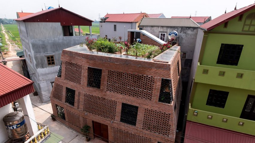 H P Architects Wraps Perforated Brick Walls Around Brick Cave House