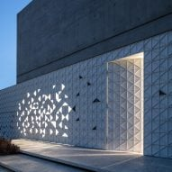 Triangles of light animate perforated aluminium facade of Tel Aviv home by Pitsou Kedem Architects