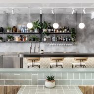 Cloudy grey surfaces and green accents appear in London's Farmer J restaurant