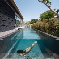 Linear swimming pool runs parallel to slate-clad Pavilion House by Pitsou Kedem