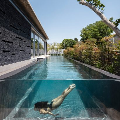 Linear pool parallels slate Pavilion House in Israel by Pitsou Kedem