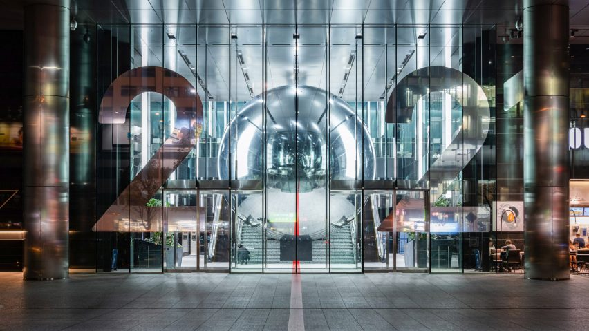 Giant mirrored ball fills staircase of Tokyo office building to encourage the city to think beyond the 2020 Olympics