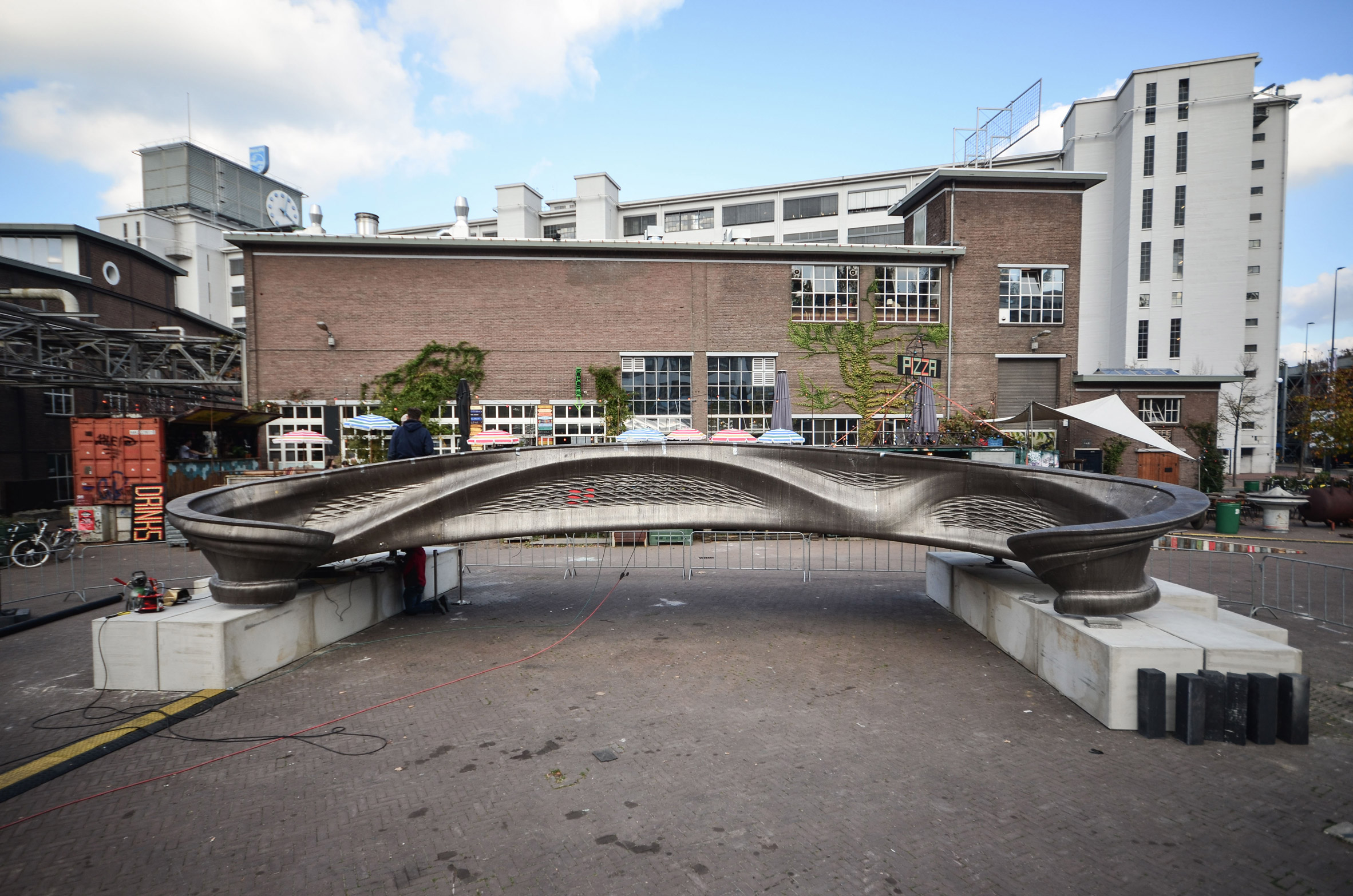 World's first 3D-printed steel bridge unveiled at Dutch Design Week