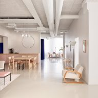 Coloured curtains stand out against white walls in Artek's Helsinki headquarters