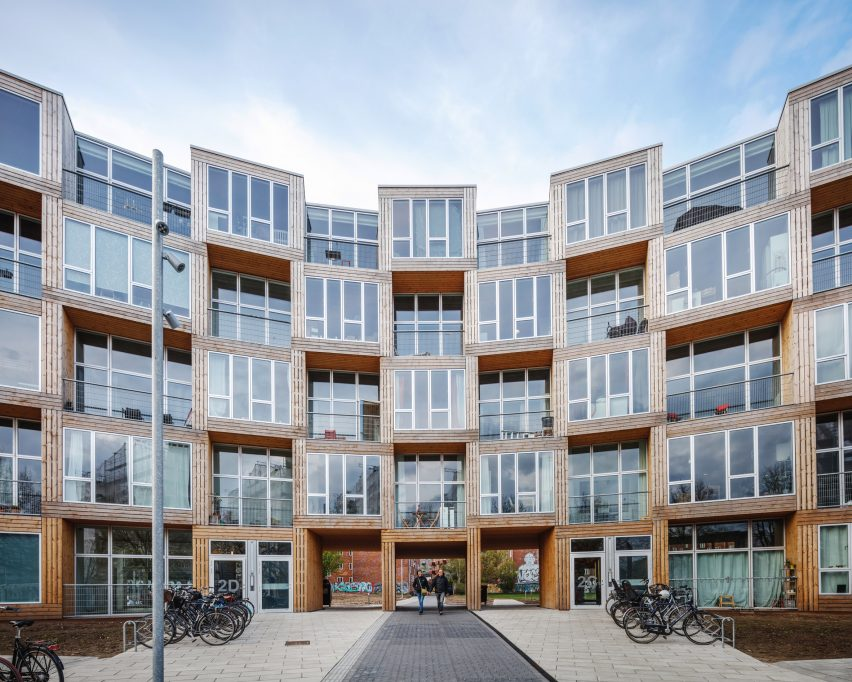 big builds winding wall of affordable housing in copenhagen