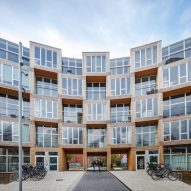 "BIG builds ""winding wall"" of affordable housing in Copenhagen"