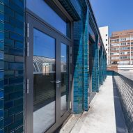 Iridescent turquoise tiles cover Damien Hirst's new flagship studio by Stiff + Trevillion