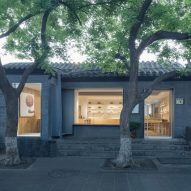 "Golucci Interior Architects creates ""simple and clean"" fan shop in Beijing hutong"
