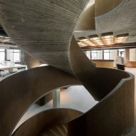 Promontorio adds concrete spiral staircase to 1980s office building in Lisbon
