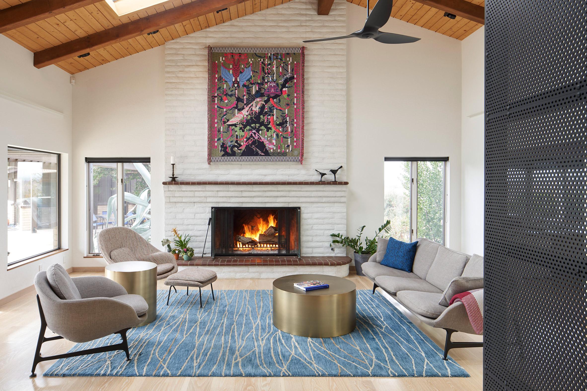 California farmhouse with white brick fireplace