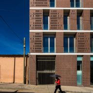 Promontorio's brick-clad Lubango Center rises above an Angolan town square