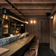 Wood, stone and adobe create cosy interior for Lima's Mérito restaurant by Ghezzi Novak and Blanco