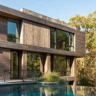 Old Sag Harbor Road house by Blaze Makoid sits in Hamptons forest clearing