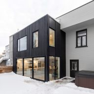 Black extension by Hatem + D and Étienne Bernier contrasts pale-brick Quebec City home