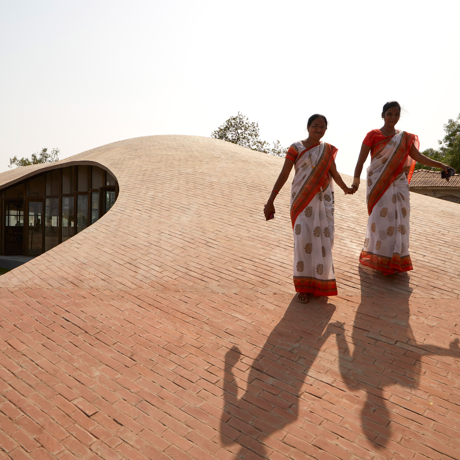Sameep Padora creates undulating brick roof to cover school library in India