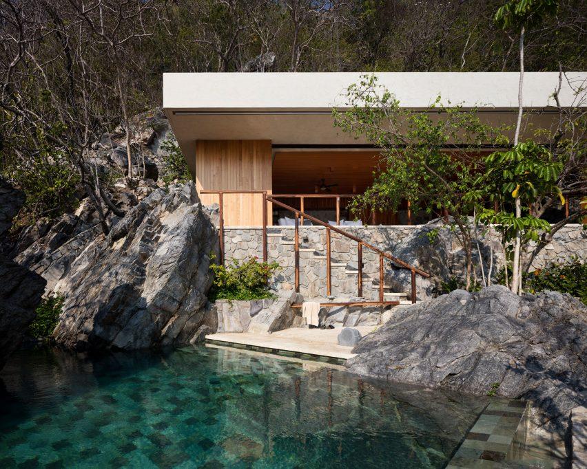 Cabana and pool by CDM cut into rocky slope on Mexico\'s coast