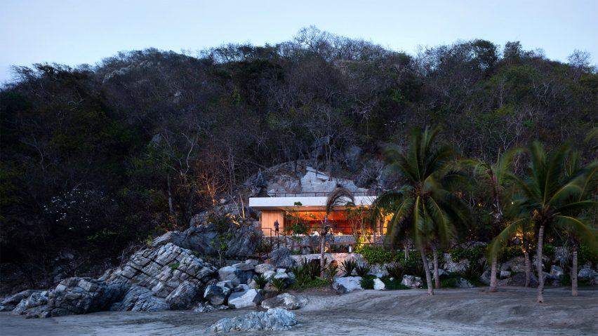 Cabana and pool by CDM cut into rocky slope on Mexico's coast
