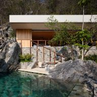 Cabana and pool by CDM cut into rocky slope on Mexico's coast