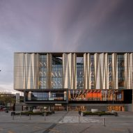 Schmidt Hammer Lassen wraps earthquake-resistant Christchurch library in golden screen