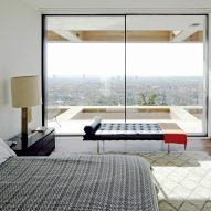 Sliding full-height windows give LA home far-reaching views