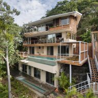 Waterfall cascades from Costa Rica beach retreat by LSD Architects