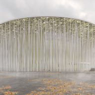 Steven Chilton Architects designs Wuxi Show Theatre with white columns and golden canopy