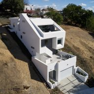 "Urban Operations slots ""sliced and folded"" white house into LA hillside"