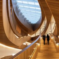 Snøhetta and Dialog's New Central Library for Calgary features vast wood-lined atrium
