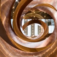 Velux skylights illuminate copper double spiral staircase in CEBRA's Experimentarium