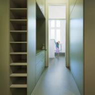 The Green Miracle is a Berlin flat featuring colour-block cabinetry and an indoor swing