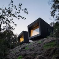 Blackened wood cabins form minimal Quebec chalet by Naturehumaine