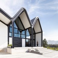 Wavelike roof imitates Andes mountains at cheese warehouse in Ecuador