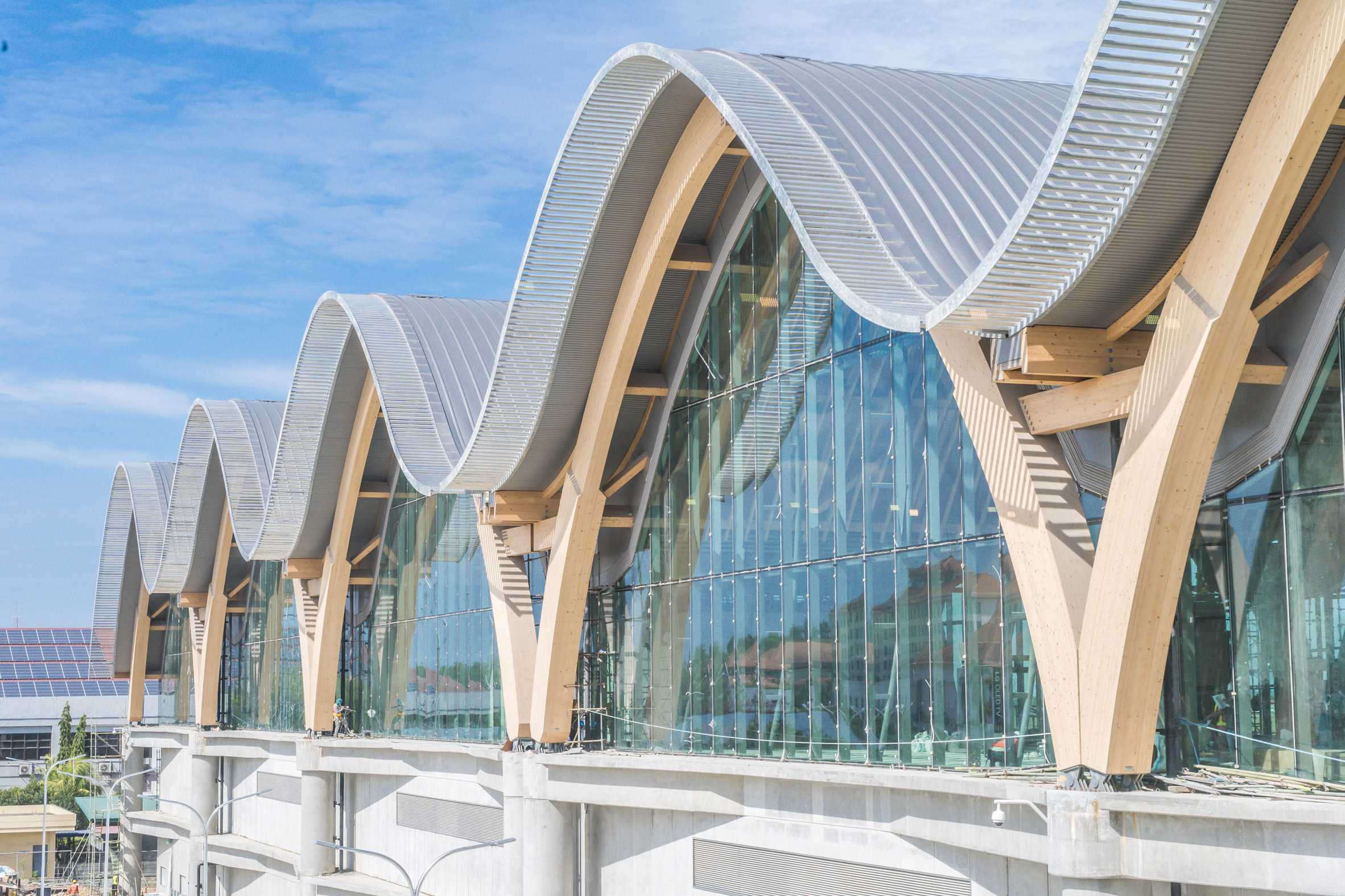 Timber arches support wavy roof of Mactan Cebu International Airport in the Philippines