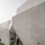 "AGi Architects' Rock House features ""origami-like"" stone facades"