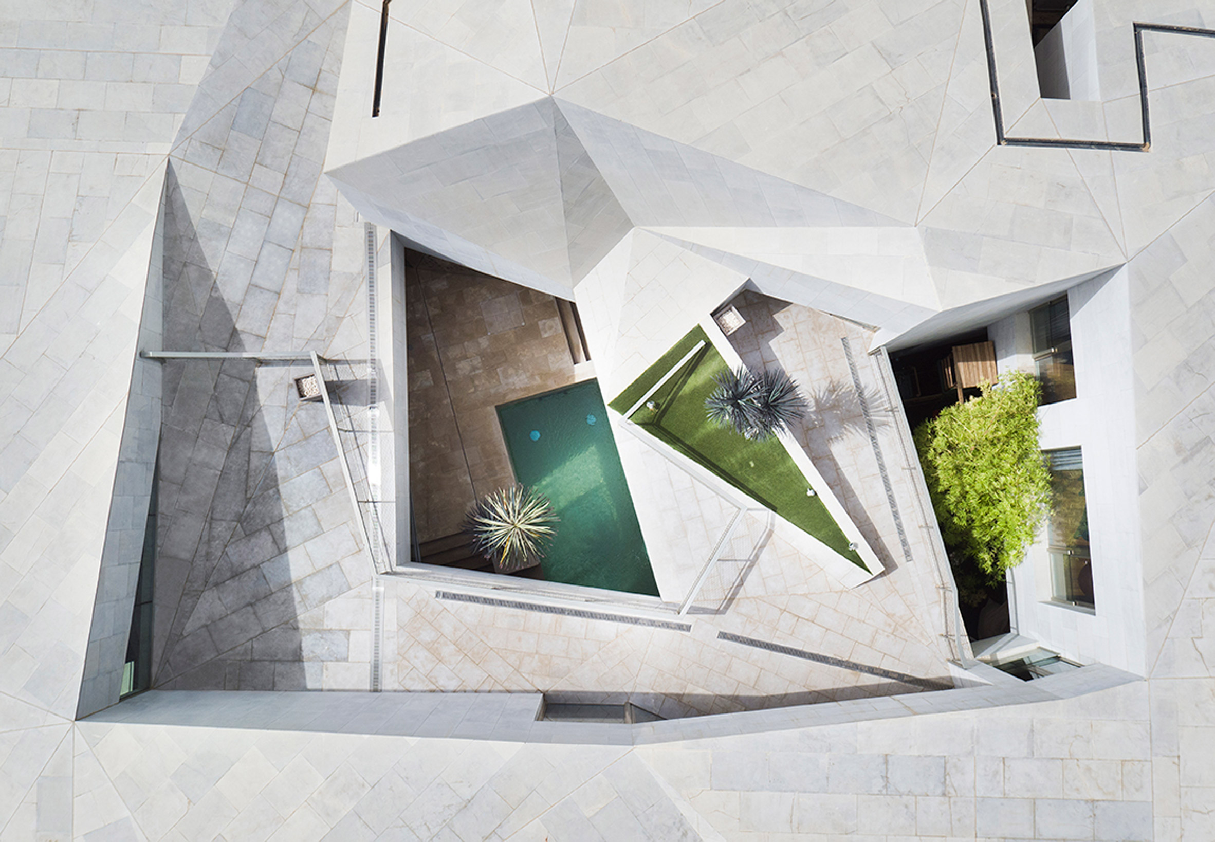 "AGi Architects' Rock House in Kuwait wrapped with ""origami-like"" stone facades"