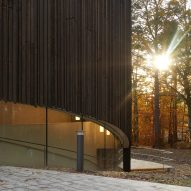Charred timber performing arts centre built by Studio Seilern in parkland campus