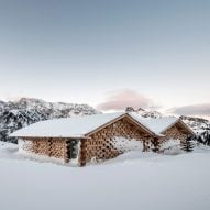 NOA extends historic Alpine retreat with cluster of cosy wooden chalets